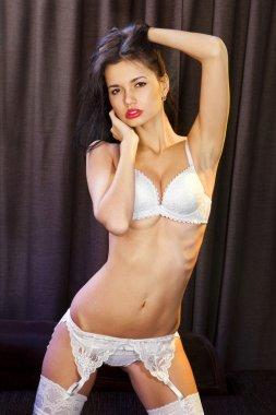 sexy woman in white underwear on sofa