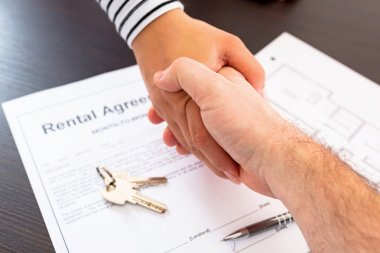 Signing rental agreement contract