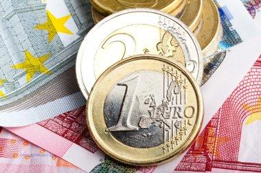 Euro coins over banknotes