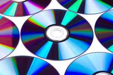 Cds and dvds on white background