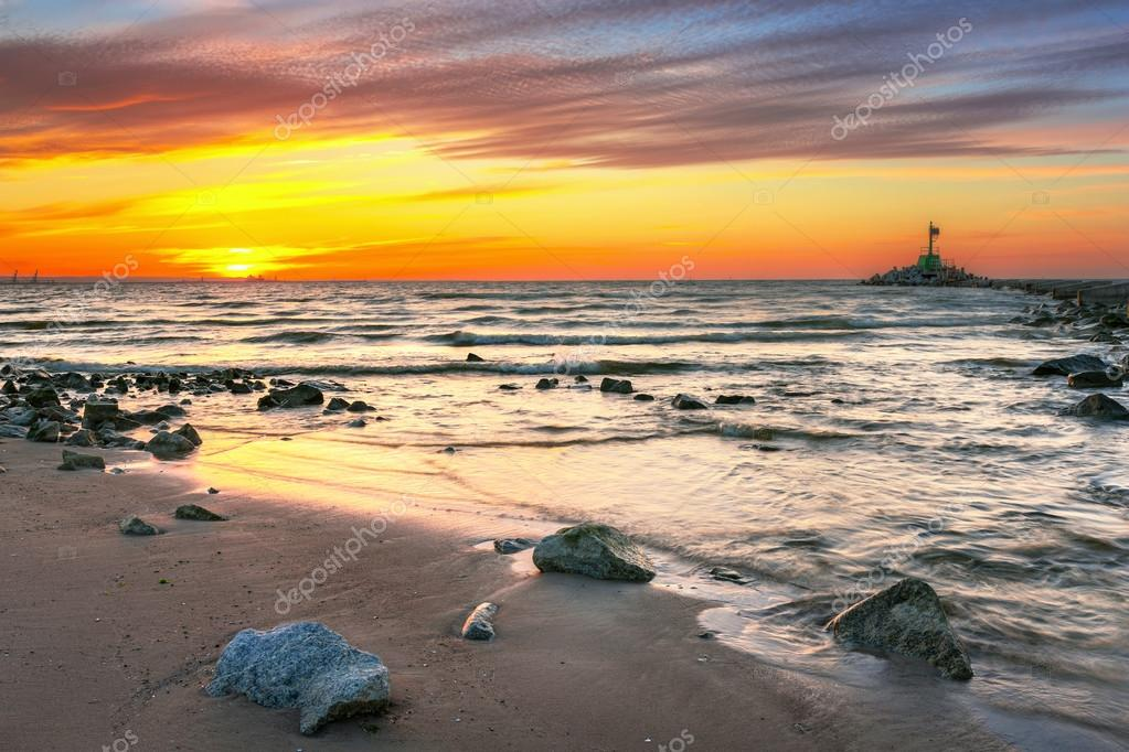 Sunset on the beach at Baltic Sea