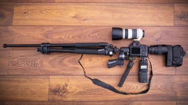 Camera equipment in the shape of machine gun
