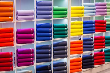 Colorful sweaters on the shop shelves