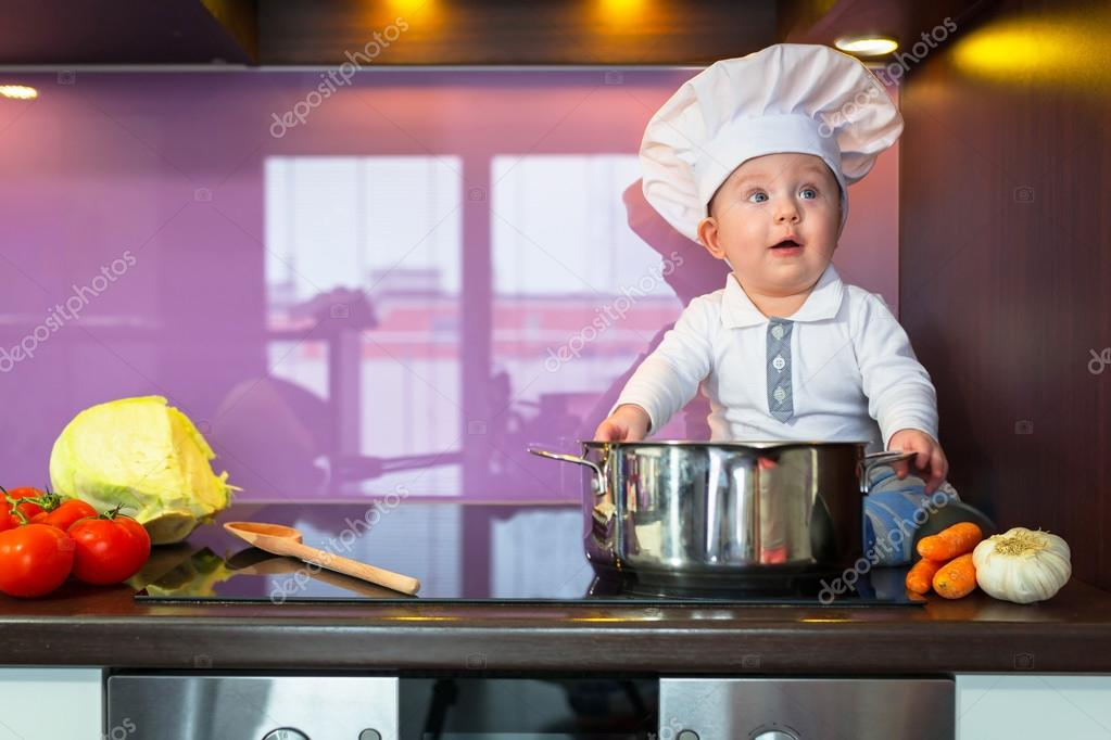 1f6abc80054 Little baby boy cook in chef hat at the kitchen. — Photo by Patryk Kosmider