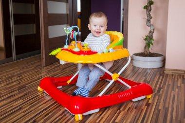 Boy in the baby walker