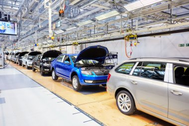 Assembling cars on conveyor line