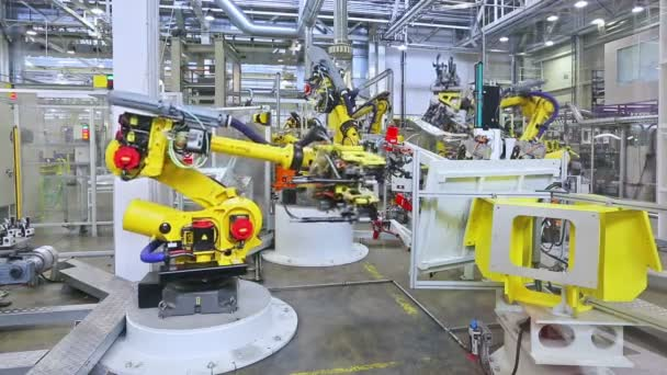 Robots and worker in a car factory