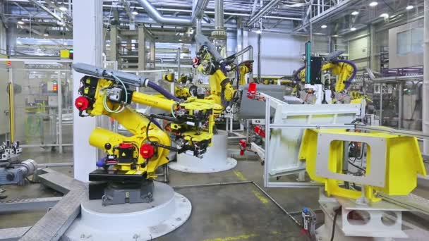 roboti v továrně na auto