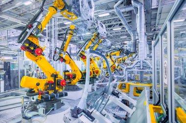 Robotic arms in a car plant stock vector