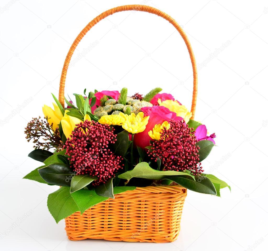 Beautiful flowers in awicker basket on light background stock beautiful flowers in a wicker basket on a light background photo by olenka 2008 izmirmasajfo