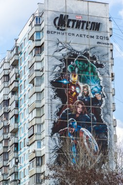 Moscow, Russia - April 04.2016. Advertising Avengers from Marvel comics on  facade of  residential building