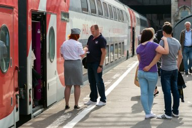 Moscow, Russia - June 14.2016. conductor checks the tickets and documents when boarding the train