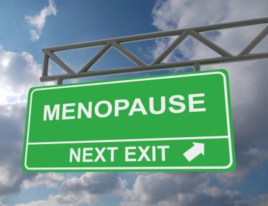 Green overhead road sign with a Menopause