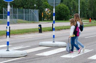 School girls on the zebra crossroad
