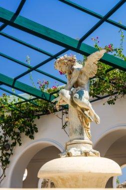 Angel statue in Kallithea rotunda - vertical view