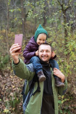 Man taking a selfie with his daughter