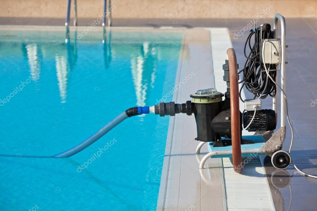 Cleaning pump working with a swimming pool — Stock Photo ...