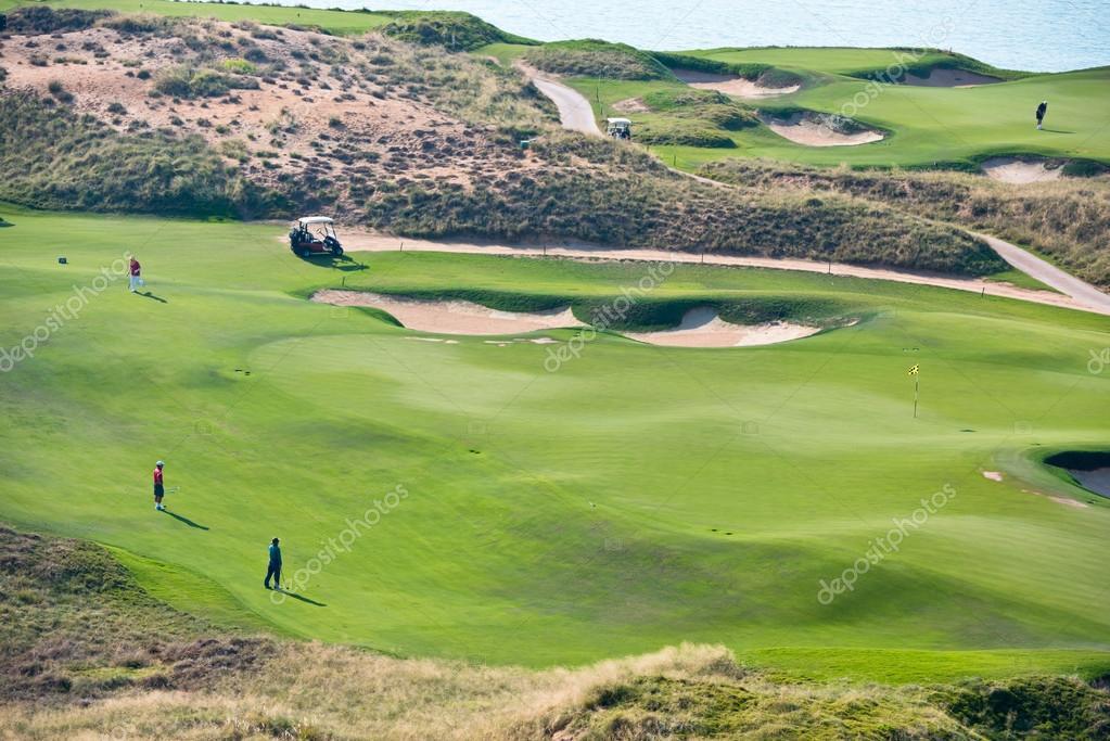 View of green golf resort field