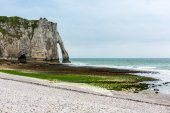 Photo The beach and stone cliffs in Etretat