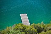Fotografie Malé dřevěné molo na vodě