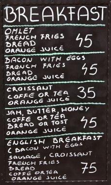 Street cafe breakfast menu written in chalk on a blackboard