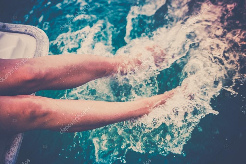 Legs splashing sea water