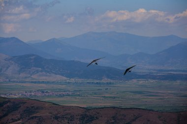 Hang glider flying in the mountains in Makedonia