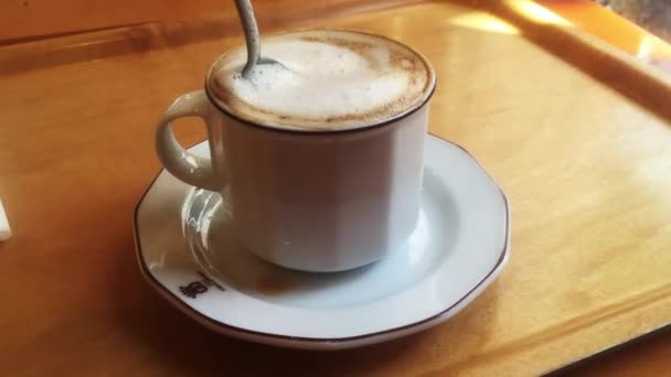 Fresh tasty aromatic cappuchino coffee on wooden table