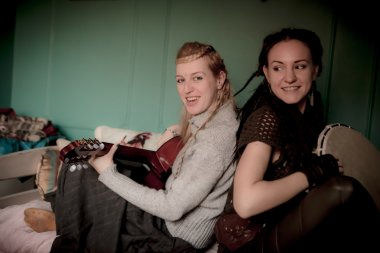 two beautiful woman with guitar
