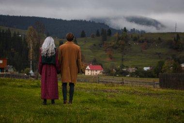 Lov couple in the autumn mountains