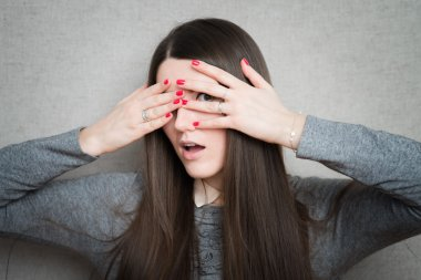 young woman closes her eyes