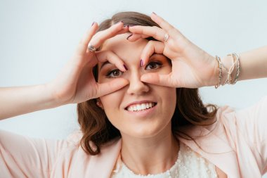girl shows hands binocular