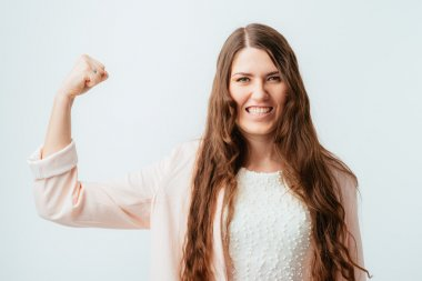 girl shows biceps