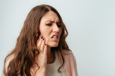 Woman has tooth ache