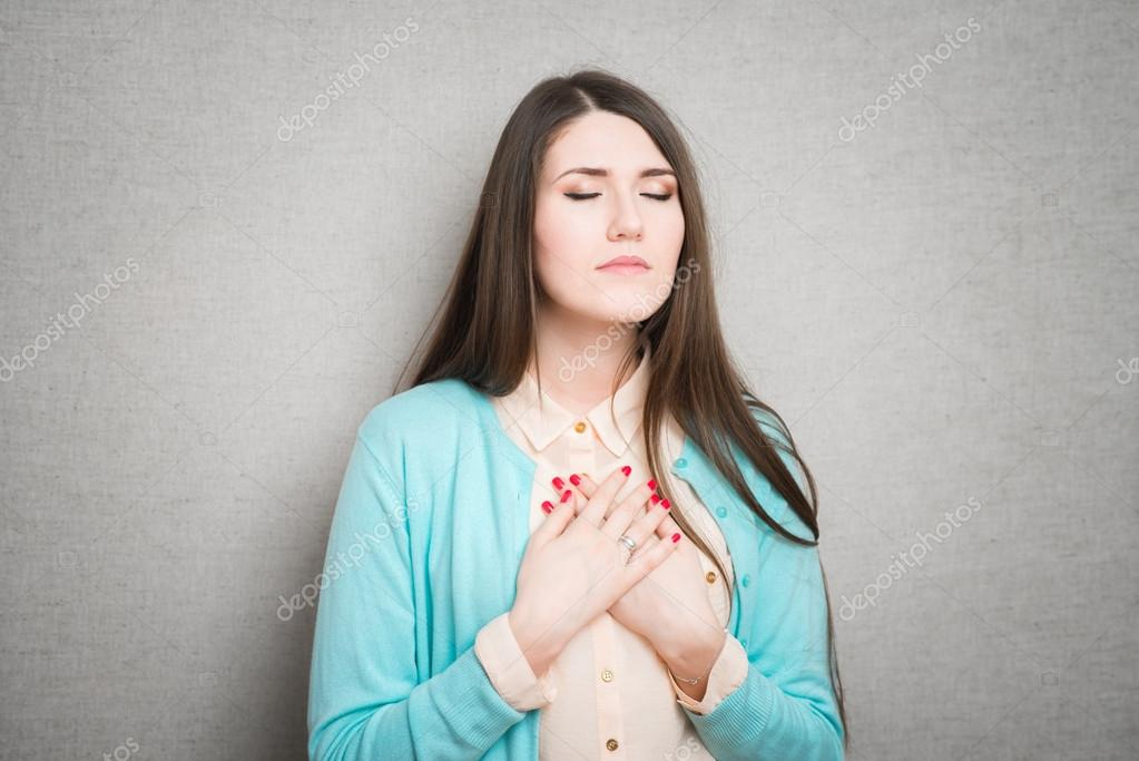 woman prays in sorrow