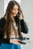 Fotografie Mädchen-Gespräch am Telefon