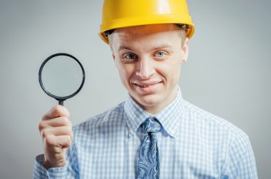 builder with magnifying glass