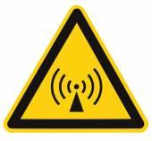 Nem-ionizáló sugárzás veszély biztonsági terület, figyelmeztető jel matrica címke, a nagy ikon indítótárcsa, az elszigetelt fekete háromszög alatt sárga, makró Vértes veszély