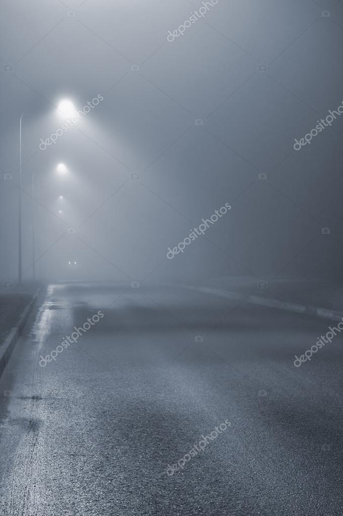 Street lights, foggy misty night, lamp post lanterns, deserted road in mist fog, wet asphalt tarmac, car headlights approaching, vertical, blue key
