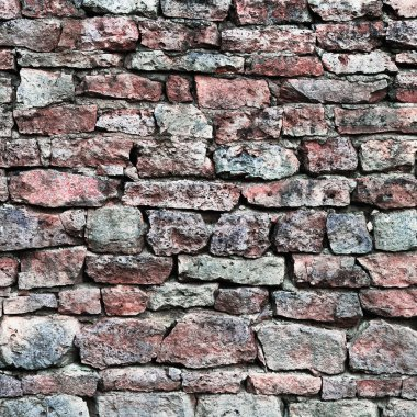 Stone wall closeup, horizontal stonewall pattern background, old aged weathered red grey grunge limestone dolomite calcium carbonate hard sedimentary slate slab rock texture, natural grungy textured bricks, beige, yellow, reddish, gray brick vintage