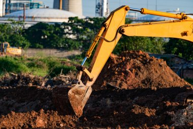 Excavators are assignments and refinery background