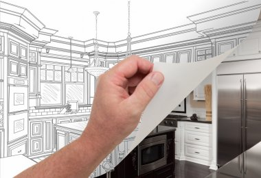 Hand Turning Page of Custom Kitchen Drawing to Photograph