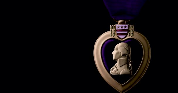 Purple Heart Medal for Military Merit Slowly Rotating On Black Background