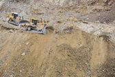 Photo Excavator Tractors Moving Dirt