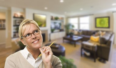 Daydreaming Woman with Pencil Inside Beautiful Living Room