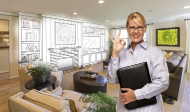 Woman with Okay Sign Over Custom Room and Design Drawing