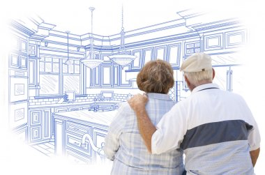 Senior Couple Looking Over Blue Custom Kitchen Design Drawing