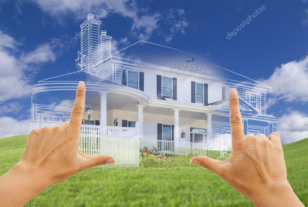 Female Hands Framing House Drawing and House Above Grass