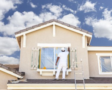 Busy House Painter Painting the Trim And Shutters of A Home. stock vector