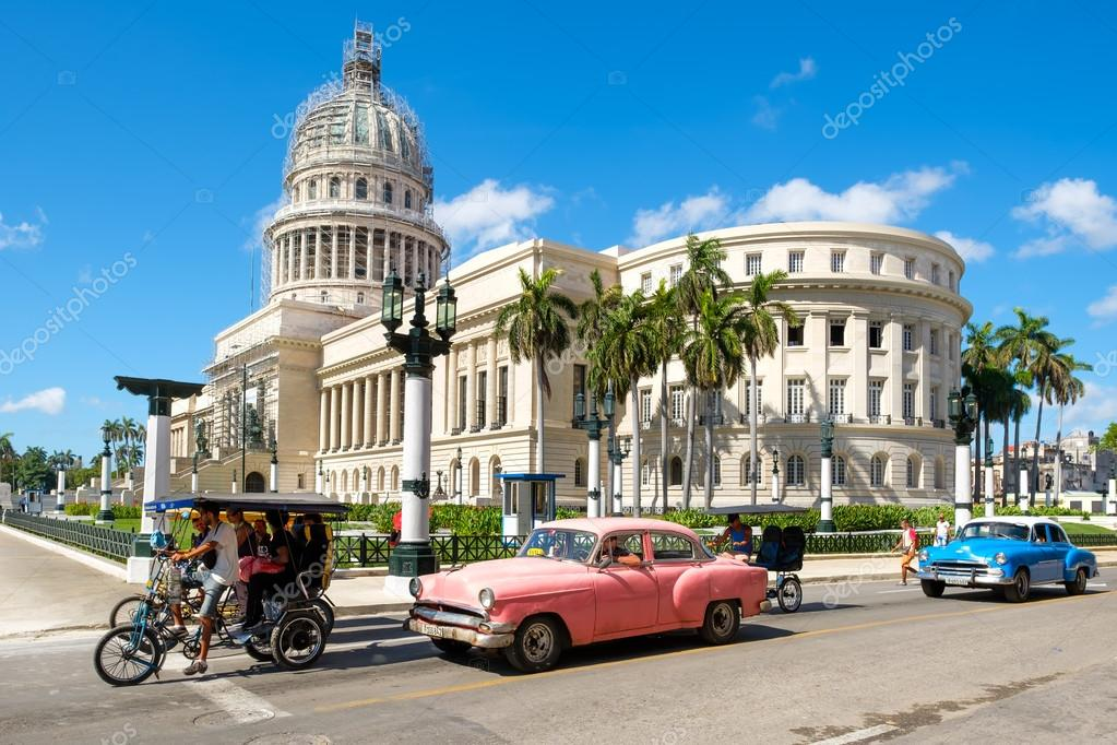 Old classic cars next to the Capitol in downtown Havana – Stock ...